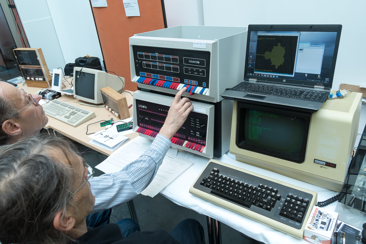 Operating the PDP-11/70, a VT-100 terminal on the right
